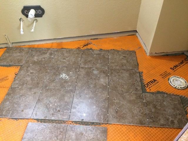 Laying tiles