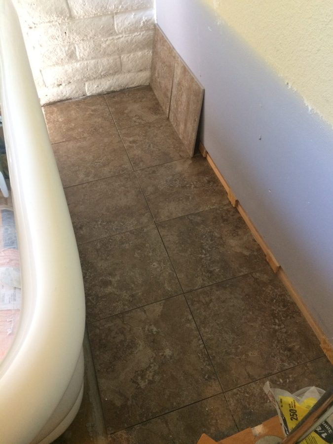 Two tiles wide behind tub