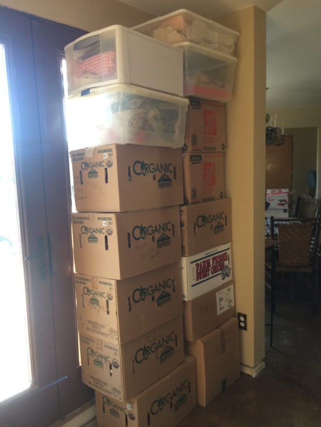 Boxes near kitchen are mostly kitchen items