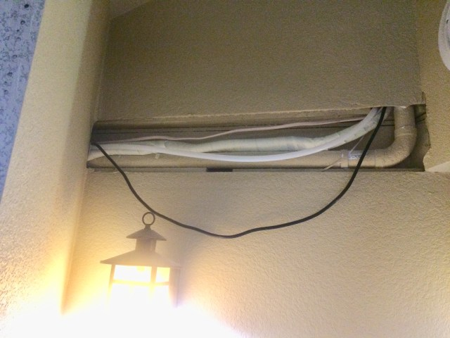 Wiring path for shower light wire