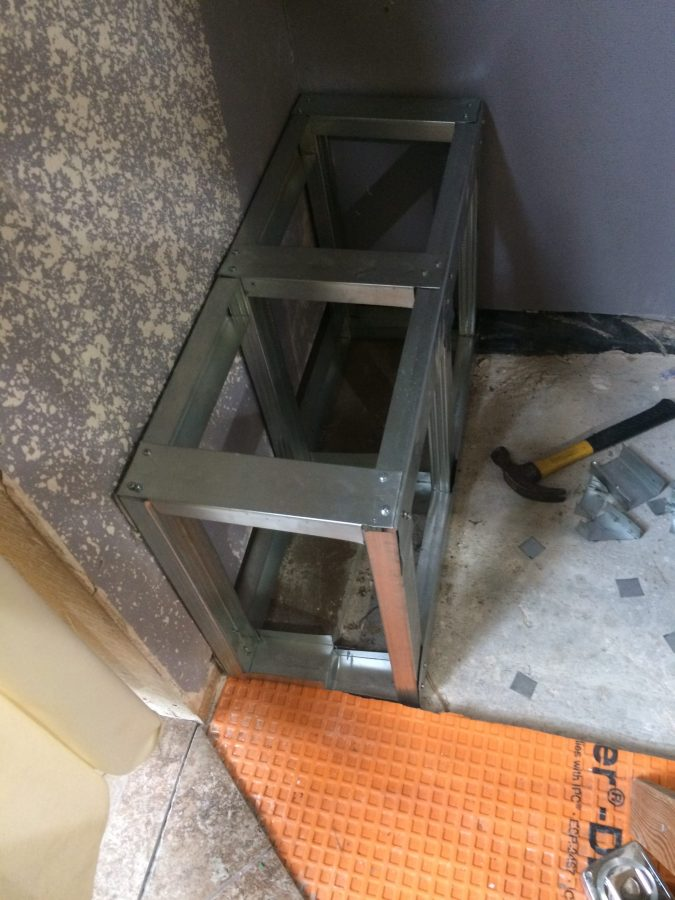 Bench fits edge of shower