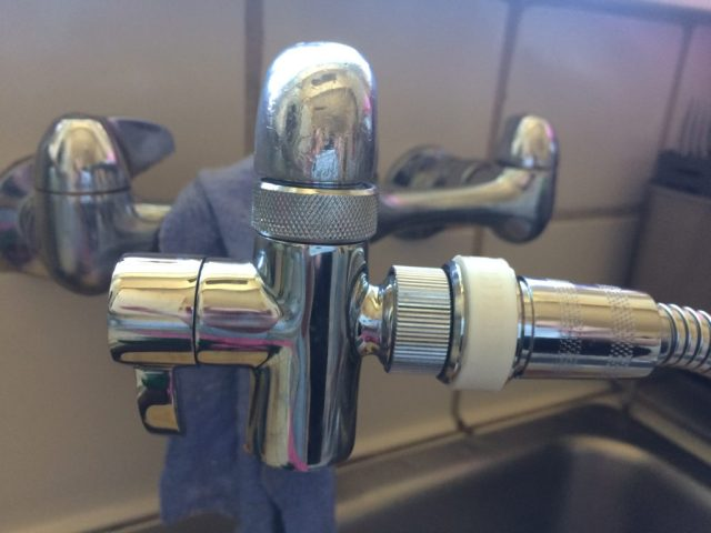 Diverter at faucet with quick connect.
