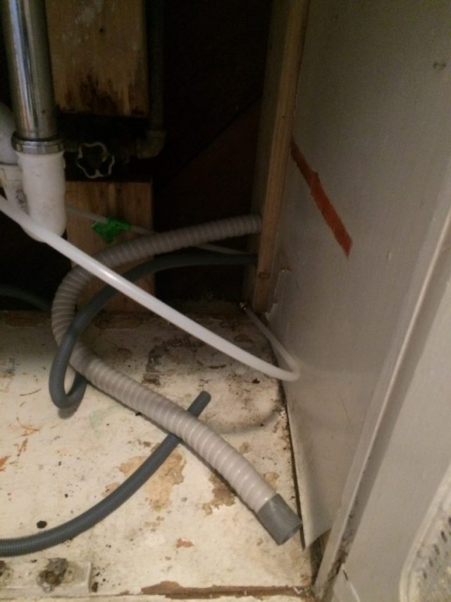 Pipes behind cabinets