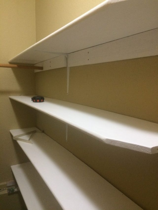 Angled shelves at the front closet door