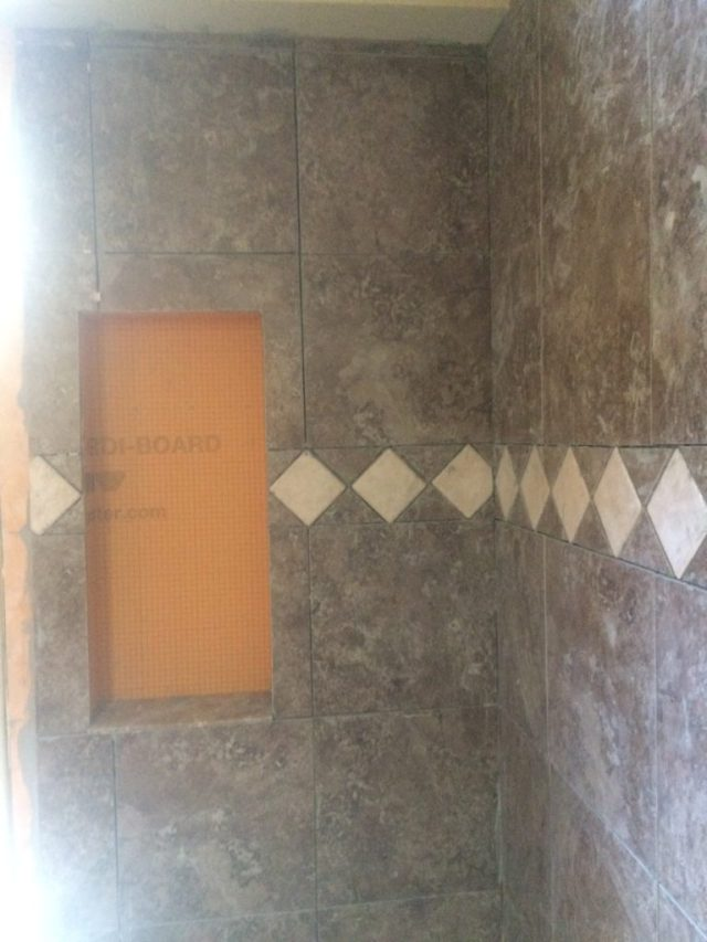 Trim tile at back wall of shower
