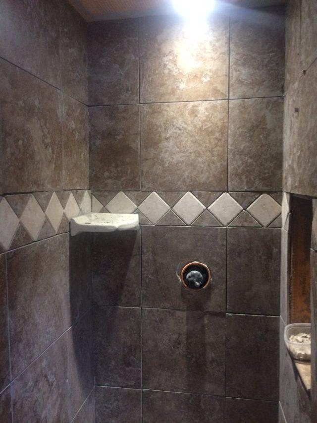 Trim tile at front of shower