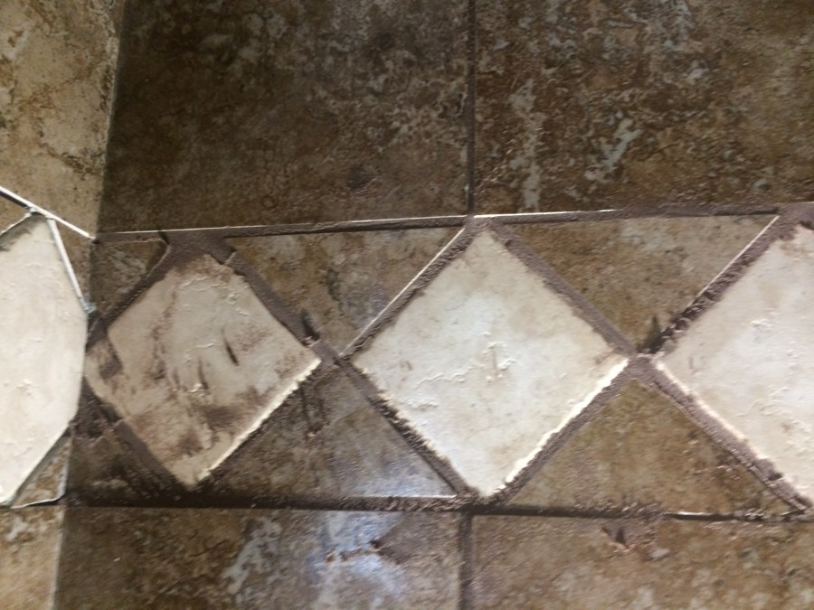 Grout scraped with float but still dirty