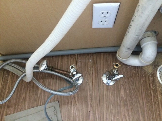 Metal cable in PVC conduit in sink cabinet
