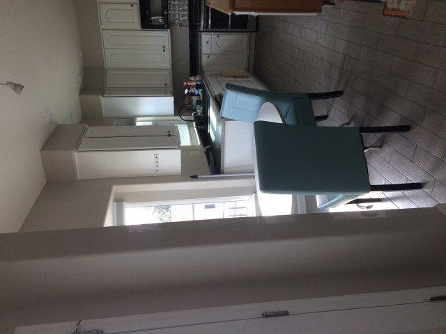 Kitchen table and blue chairs