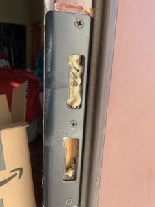 Strike plate shows damage where device was stuck