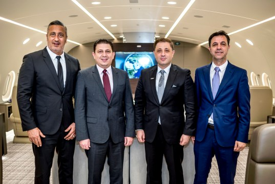 The Four Founders of UAS Celebrate Charter Management of the Dream Jet