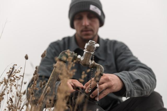 Man with Water Camping