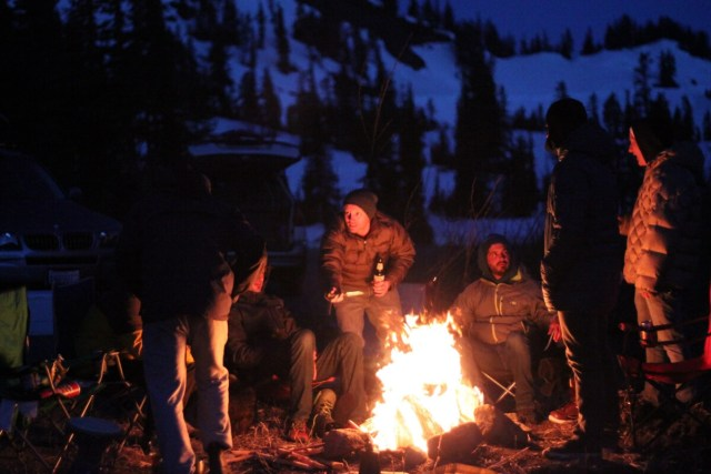 Group of people in front of campfire