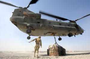A Royal Air Force Chinook Helicopter Lifts Supplies At Camp Bastion, Afghanistan