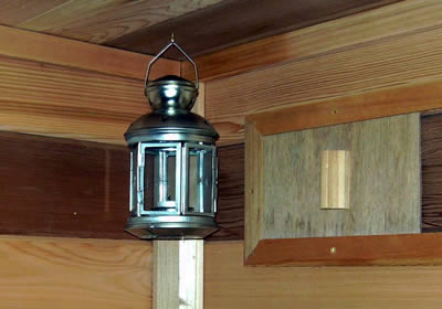 Lantern mounted inside the sauna under the ceiling