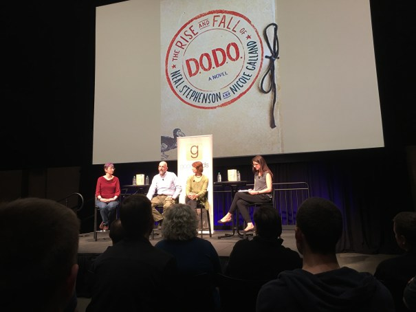 Four people sit on a stage at the Amazon Meeting Center in front of a Goodreads banner and the projected cover of the book. Neal is second from left and Nicole is third.
