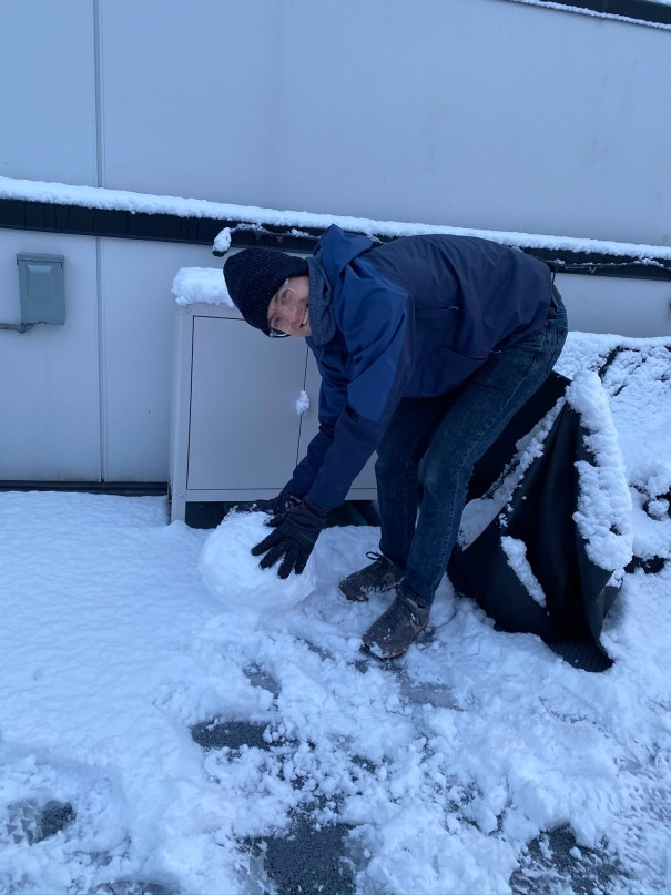 Nick rolling the main ball of a snow person