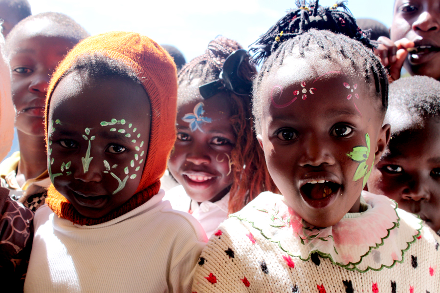 These children enjoy face painting during their Christmas celebration.
