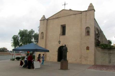 Elsa and Colleen set up their Unbound information table outside the San Gabriel Mission Parish.