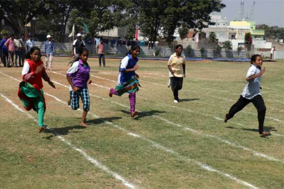 Sponsored girls compete in a foot race.