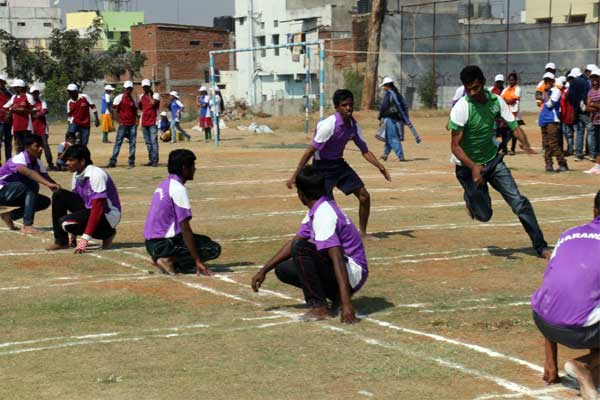 Sponsored youth play the traditional Indian game kho kho.