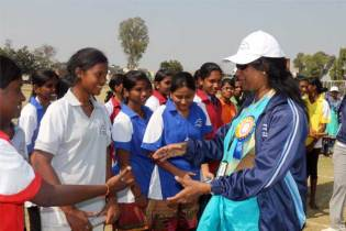 Sarita Mendanha, program coordinator for Unbound in Hyderabad, greets sponsored youth participating in the sports day.