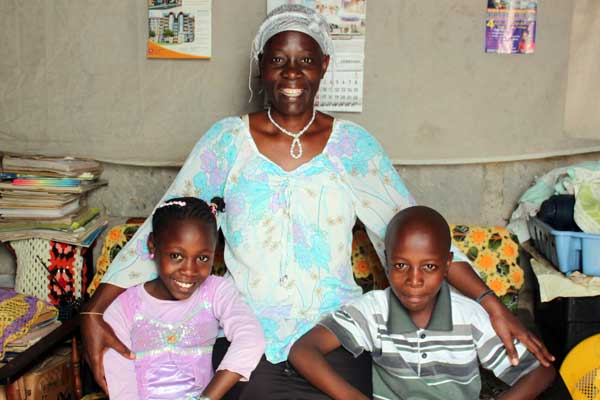 Mary with her two youngest kids, Veronica and Elijah, who are sponsored through Unbound in Kenya.