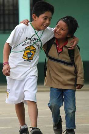 From left: Good friends Sergio and Ervin, two sponsored children in Guatemala, walk together after class. Photo Credit: Luis Cocón