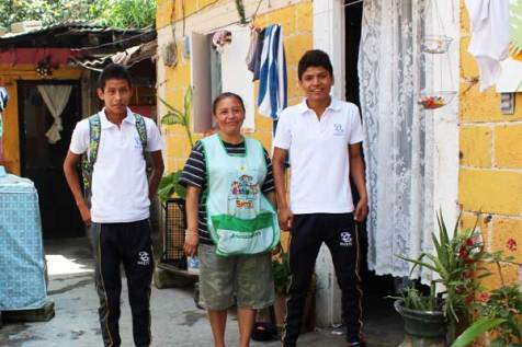 With the help of her son Maricio (left), a sponsored youth, and her brother Abelardo (right), Maria is able to supplement her family's income with materials she collects for recycling and repair.
