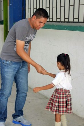 John shakes hands with one of his students.