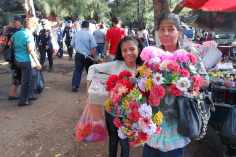 Norma and Leti sell their handmade decorations outside the cemetery to others celebrating Day of the Dead.