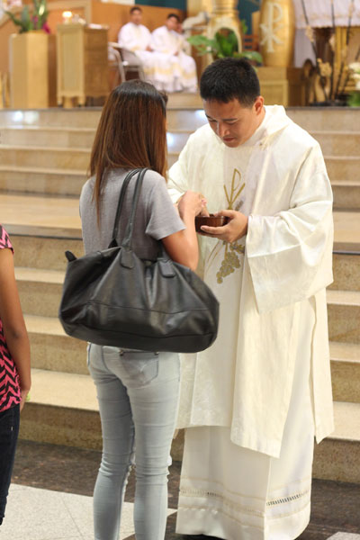 Distributing Holy Communion at Mass.