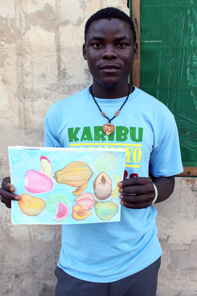 Shija, an Unbound sponsored youth in Tanzania, shows artwork he created.