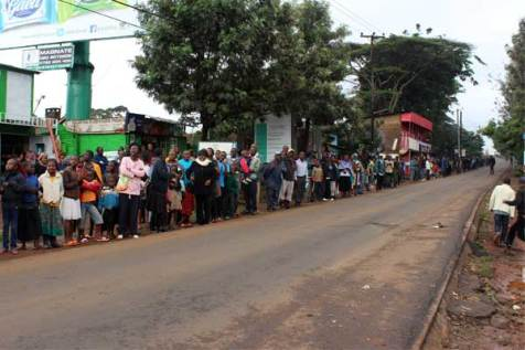 Kenyans line the streets in anticipation of Pope Francis' motorcade.