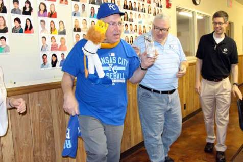 Father Mike Rieder makes good on his bet over the results of the 2015 World Series.