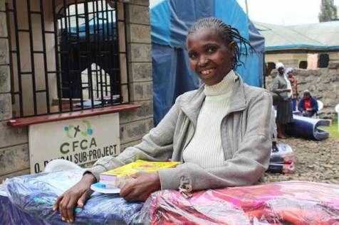 Veronica, whose daughter Rosemary is sponsored through Unbound, had to relocate after her rented home flooded. She received rent money and items for her new home as part of flood assistance from Unbound.