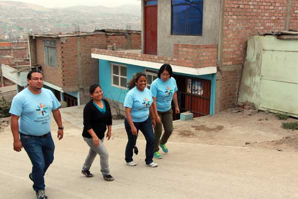 Fania Carnero, second from right, visits the homes of Unbound sponsored members with other staff members from Lima, Peru.