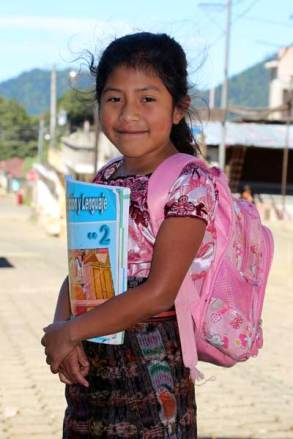 "Gilberta heads to school with her book and pink backpack. ""I love school,"" she said."