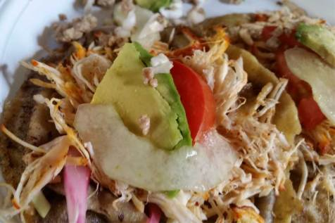 A delicious homemade meal of panuchos, which are typical Yucatán tacos.