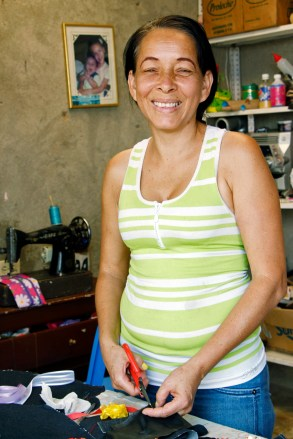 A Colombian woman making shoes.