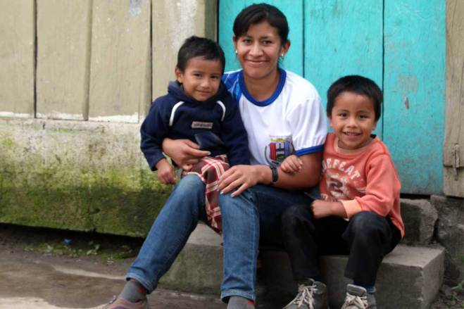 An image of Blanca with her sons Mynor and Osber.