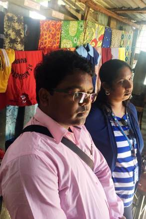 An image of Unbound staff members in a tailor shop.