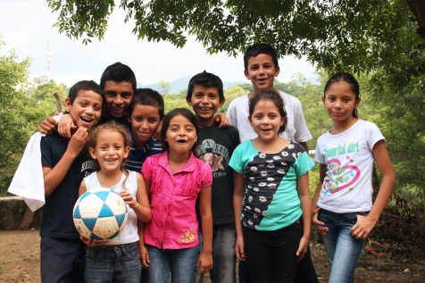 A group of children in El Salvador get ready to play a game of soccer.