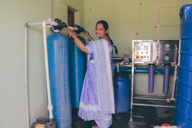 Asma checks on the machinery required to filter the water.