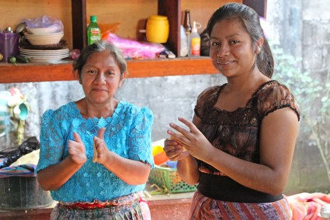 Transita (right) and her mother, Gilberta, make tortillas together.