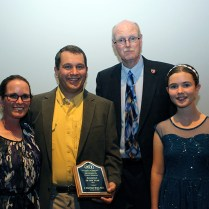 Alumnus of the Year J. Matthew Byrd and family with Chairman Michael Sitorius