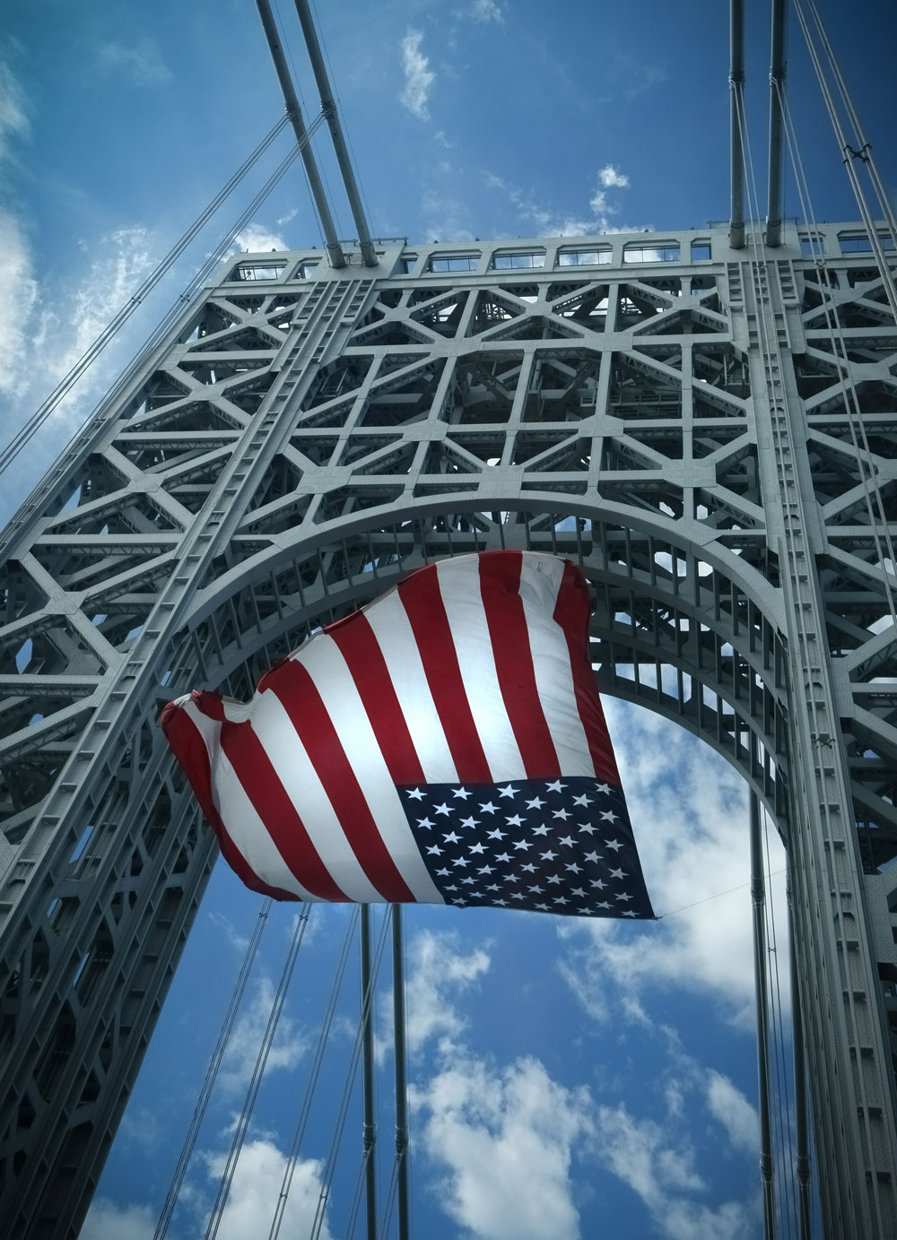USA flag in the wind on George Washington Bridge