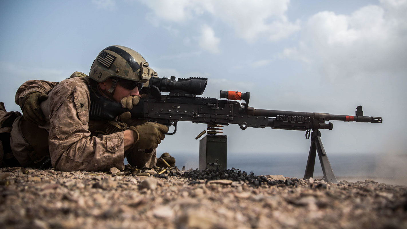 Djibouti - Lance Cpl. Blake Palicki, a rifleman with the Maritime Raid Force (MRF), 11th Marine Expeditionary Unit, fires on targets with an M240B medium machine gun during a machine gun and demolitions range at Arta Beach, Djibouti, Feb. 6.