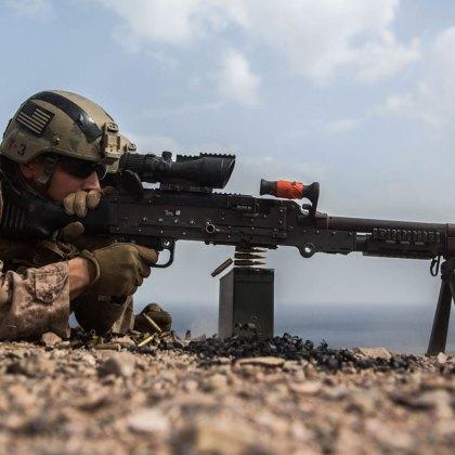 Djibouti - Lance Cpl. Blake Palicki, a rifleman with the Maritime Raid Force (MRF), 11th Marine Expeditionary Unit, fires on targets with an M240B medium machine gun during a machine gun and demolitions range at Arta Beach, Djibouti, Feb. 6.