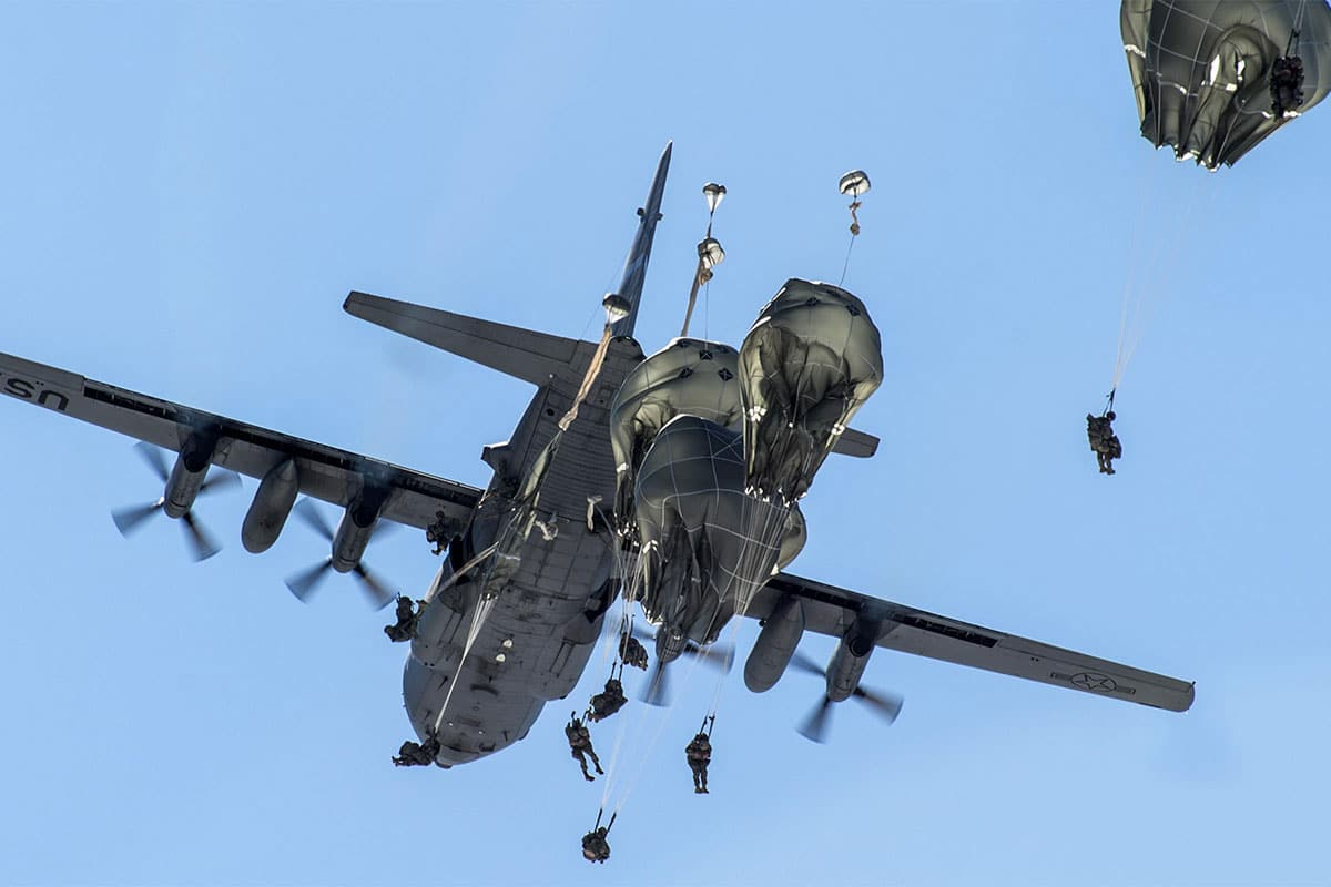 Paratroopers jump out of a Nevada Air National Guard C-130H Hercules while conducting airborne training at Joint Base Elmendorf-Richardson, Alaska.